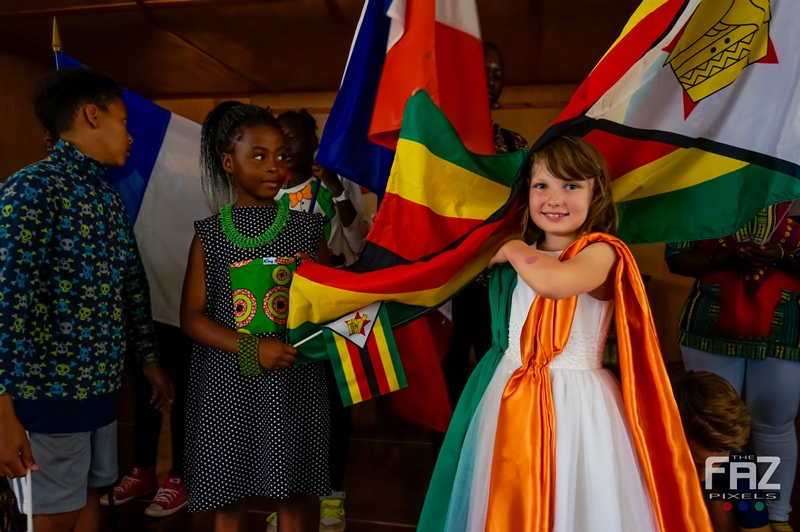 Children Displaying Flags